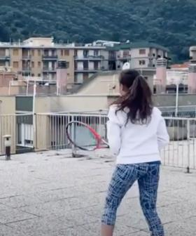 Two Women Play Rooftop Tennis During Quarantine