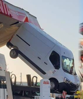 The Bizarre Reason As To How This Van Got Lodged Between The Roof And Floor Of A Servo